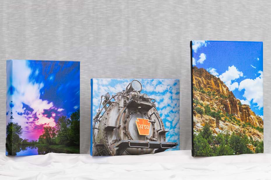 photo of three canvases on a table